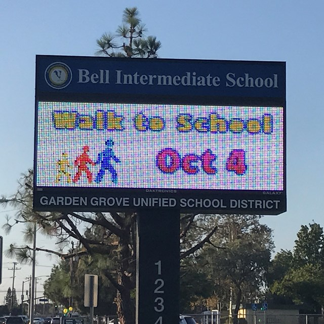 Our electric sign promotes Walk to School Day! Did you get the memo?