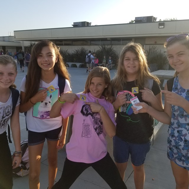 These five lovely ladies show off their school spirit with Roadrunner stickers!