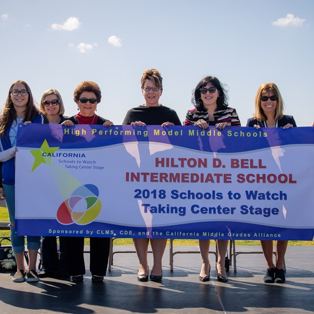 Bell roadrunners are proud to announce their award-winning status alongside superintendent Dr. Mafi!
