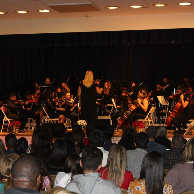 Our orchestra performs passionate pieces for the community. Great job scholars!