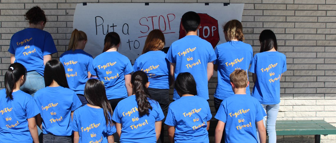 ASB members turn their backs on bullying, because together we thrive!